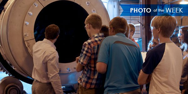Students from Brown County's Teen Leadership program look at the interior of a rotary dryer.